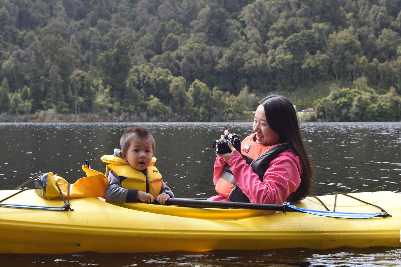 mother and child in sea kayak on lake mapourika
