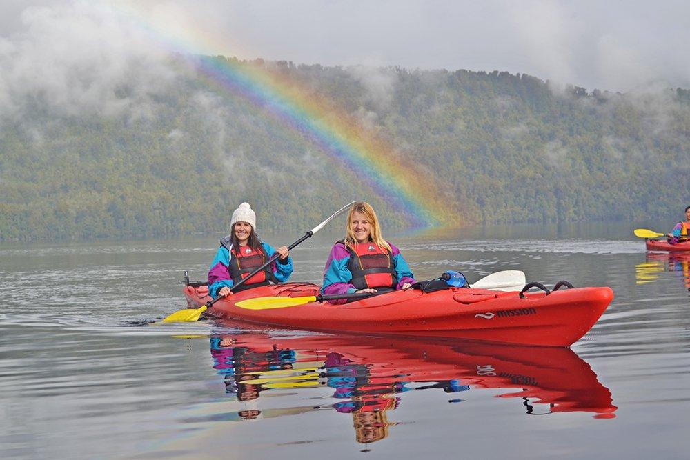kayak on lake mapourika with rainbow